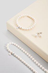 """Parure """"infinity"""" collana, bracciale e orecchini con perle d'acqua dolce AAA"""